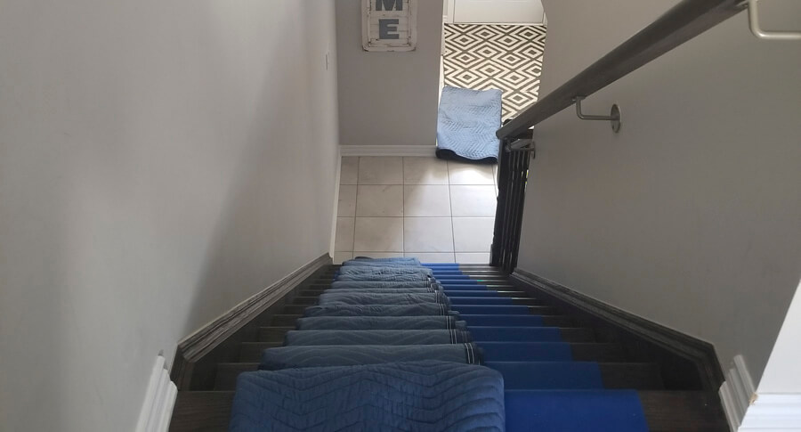 Clean moving blankets and runners to protect your floor and stairs when moving